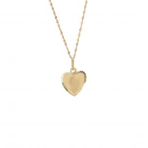Złoty medalik w kształcie serca