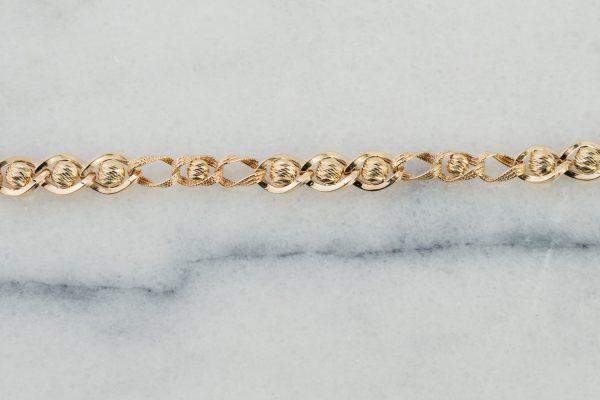 Grubsza złota bransoletka , skręcona, diamentowana